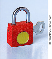 padlock with the key on a blue