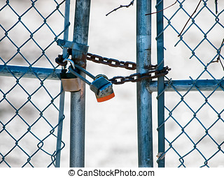 Padlocks and chain on gate - Three rusty old padlock and...