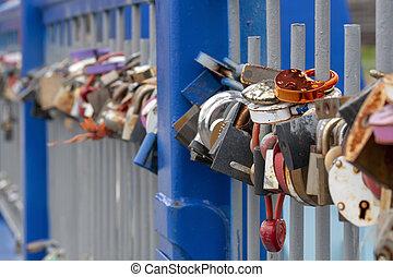 Padlocks on a bridge symbol of eternal love