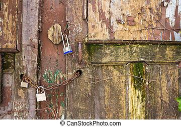 Padlocks on an old door