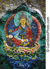 This is Guru Rinpoche, known as Second Buddha in Bhutan. Devout Buddhists painted many sacred images on rocks, this is just one of them. This is a generic painting, not copyrighted.