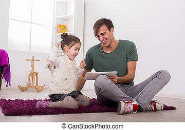 padre, hija, tableta