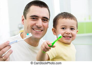 padre y niño, hijo, cepillar dientes, en, cuarto de baño
