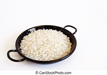 Paella pan and rice - Spanish pan for paella with uncooked...