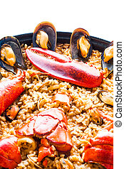 Traditional spanish paella isolated on white background.