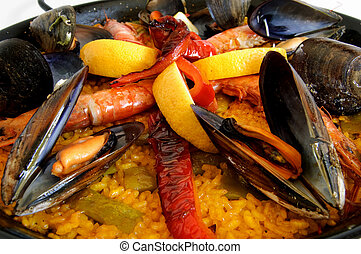 Paella - Traditional spanish rice with mussels, prawn and red pepper