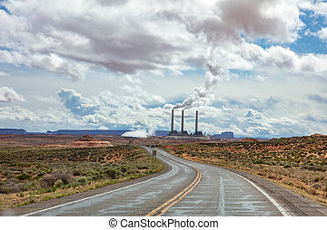 Page Arizona power plant. Long winding highway in the american desert, blue sky with clouds