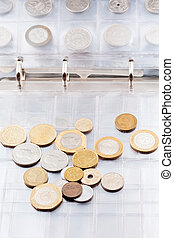 numismatics album with different coins - page of numismatics...