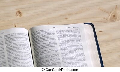 Pages turn by themselves in New Testament - A Bible lays...