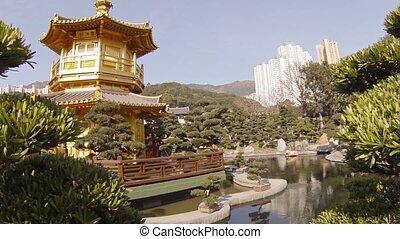 Pagoda, Gardens and Pond of Chi Lin Nunnery in Hong Kong. -...
