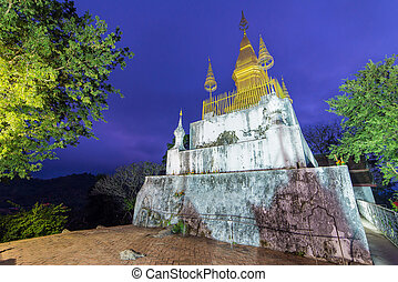 Pagoda of Phu Si Temple at twilight time in Luang Pra bang, Laos