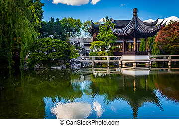 Pagoda reflecting in a pond at the Lan Su Chinese Garden, in...