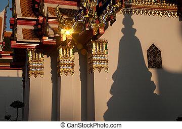 Pagoda shadow on the wall .