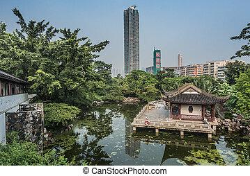 pagoda temple pond Kowloon Walled City Park Hong Kong -...