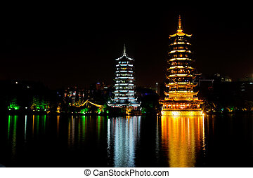 Colorful pagodas representing the sun and the moon, Fir lake, Guilin, China