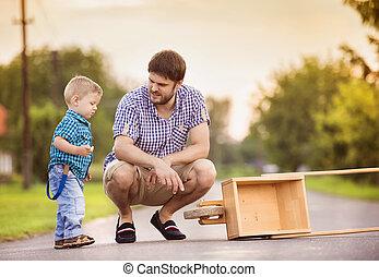 pai filho, ligado, estrada, com, carrinho de mão