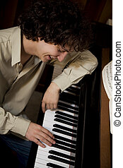 paiano man - young composer enjoying his new song and ...