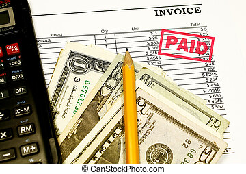 Paid Invoices with calculator, pencil and dollars