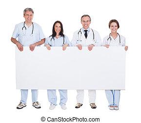 painél publicitário, grupo, segurando, doutor