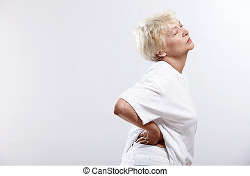 Pain - An elderly woman clinging to the waist on a white ...