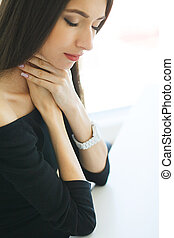 Pain. Business Woman suffering from a neck pain from bad posture in her an office.