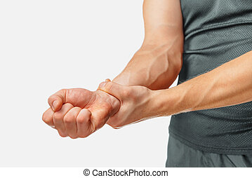 Pain in a male wrist, close-up image