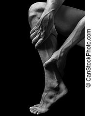 Pain in calf muscle - Acute pain in male calf muscle, black...