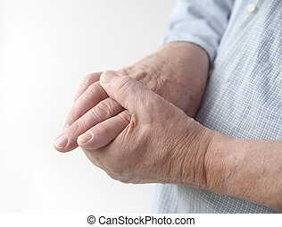 pain in finger joints - a man with painful joints on his...