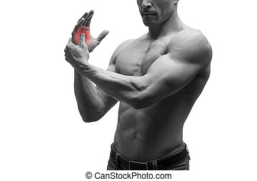 Pain in hand, carpal tunnel syndrome, muscular male body, studio isolated shot on white background with red dot