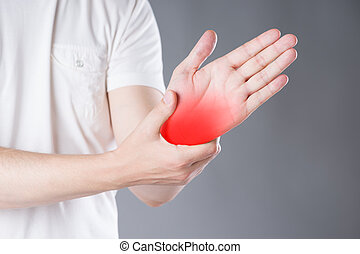 Pain in hand, carpal tunnel syndrome on gray background,...