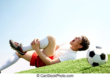 Pain in leg - Image of soccer player lying down and shouting...