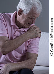 Pain in shoulder joint - Senior sad man with acute pain in...