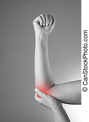Pain in the joints of the hands. Care of female hands. Pain in the human body on a gray background