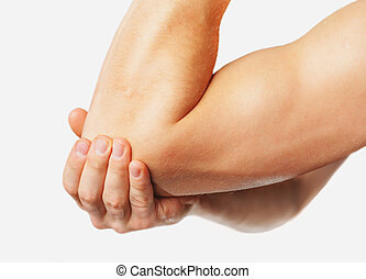 Pain in the male elbow - The man is touching the elbow due...