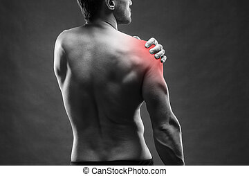 Pain in the shoulder. Muscular male body. Handsome...