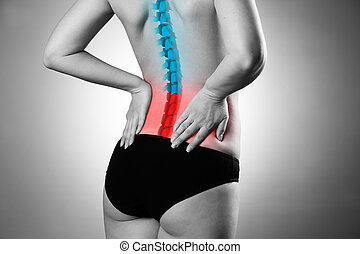 Pain in the spine, woman with backache, injury in the lower back