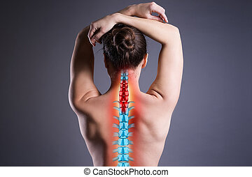 Pain in the spine, woman with backache on gray background, back injury