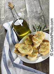 pain italien, huile, bouteille, rôti