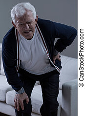 Pain of lower back - Senior man suffering for terrible pain ...