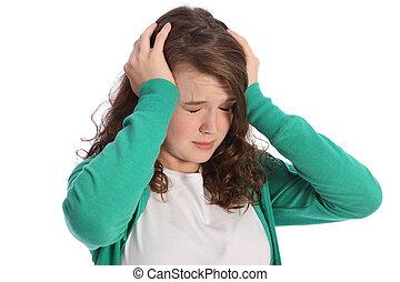 Pain of stressed teenager girl in despair - Head in hands ...