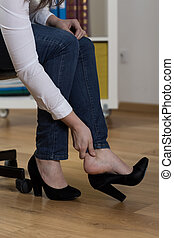 Painful feet after day in high-heeled shoes