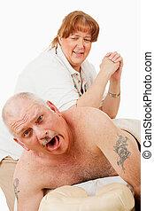 Painful Massage - Humorous photo of a man surprised by a...