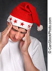Painful Teenager in Santas Hat