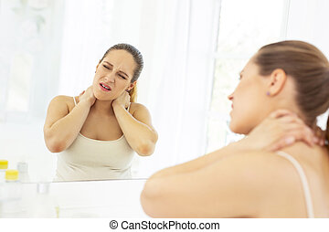 Painful tragic woman experiencing neck ache