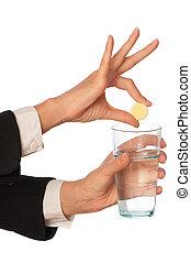 Painkiller - Businesswoman throws a pill from headache to...