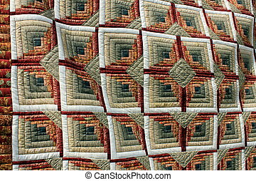 Gorgeous patterns and textures of painstaking craft in quilting.