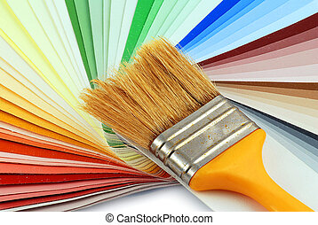 Paint bruh and colors - Paint brush laying on a heap of...