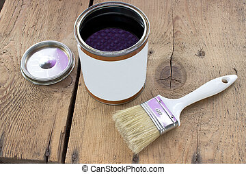 Paint brush and varnish can on wooden background