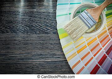 Paint brush color pantone fan adhesive tape on wood board