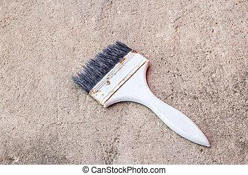 Paint brush on the cement floor